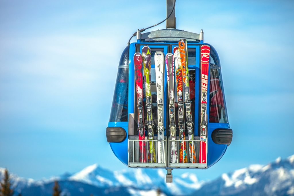 Skis attached to back of chairlift