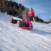Children playing in snow at Alpine ski resort