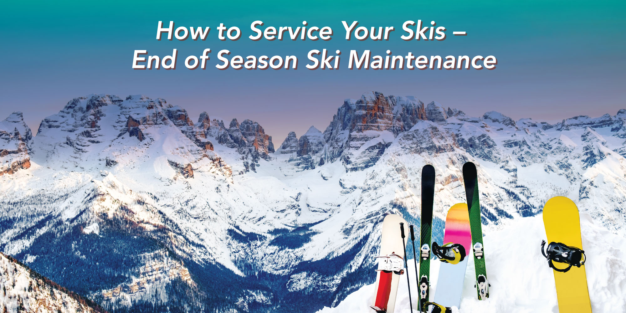 Skis and snowboards at edge of high mountains