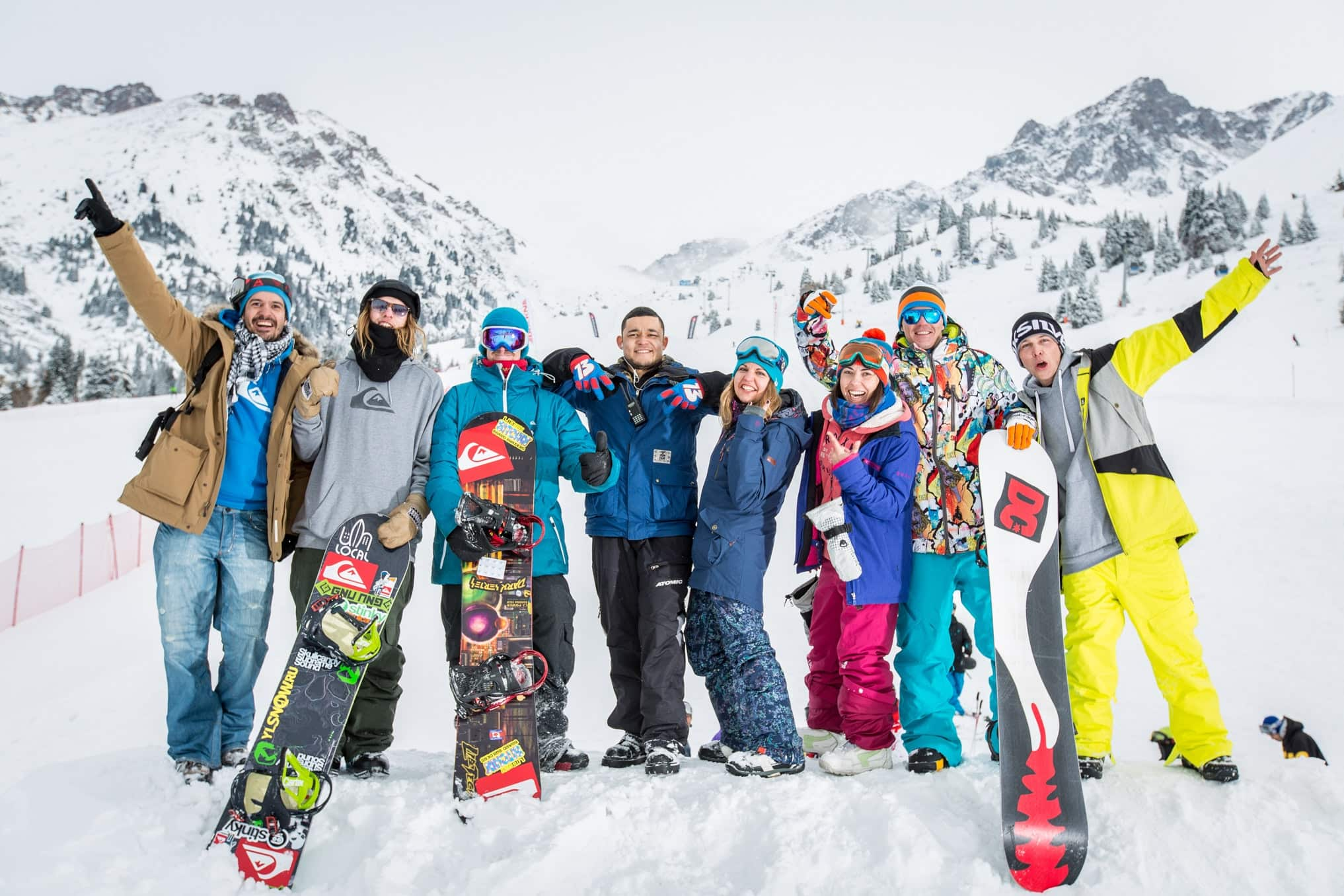 Group of skiers with mountains behind them
