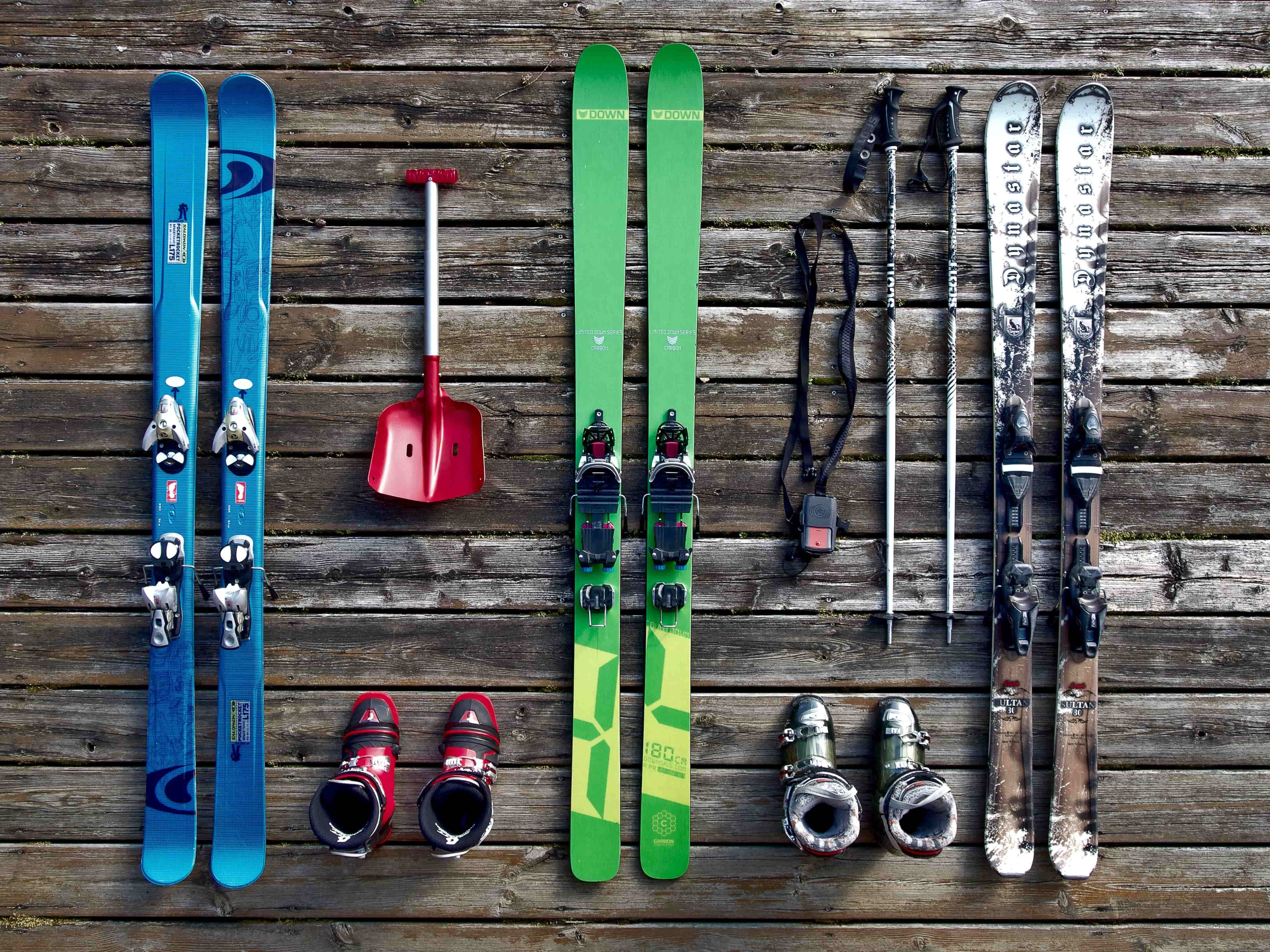 Skis, ski poles and ski boots on floor