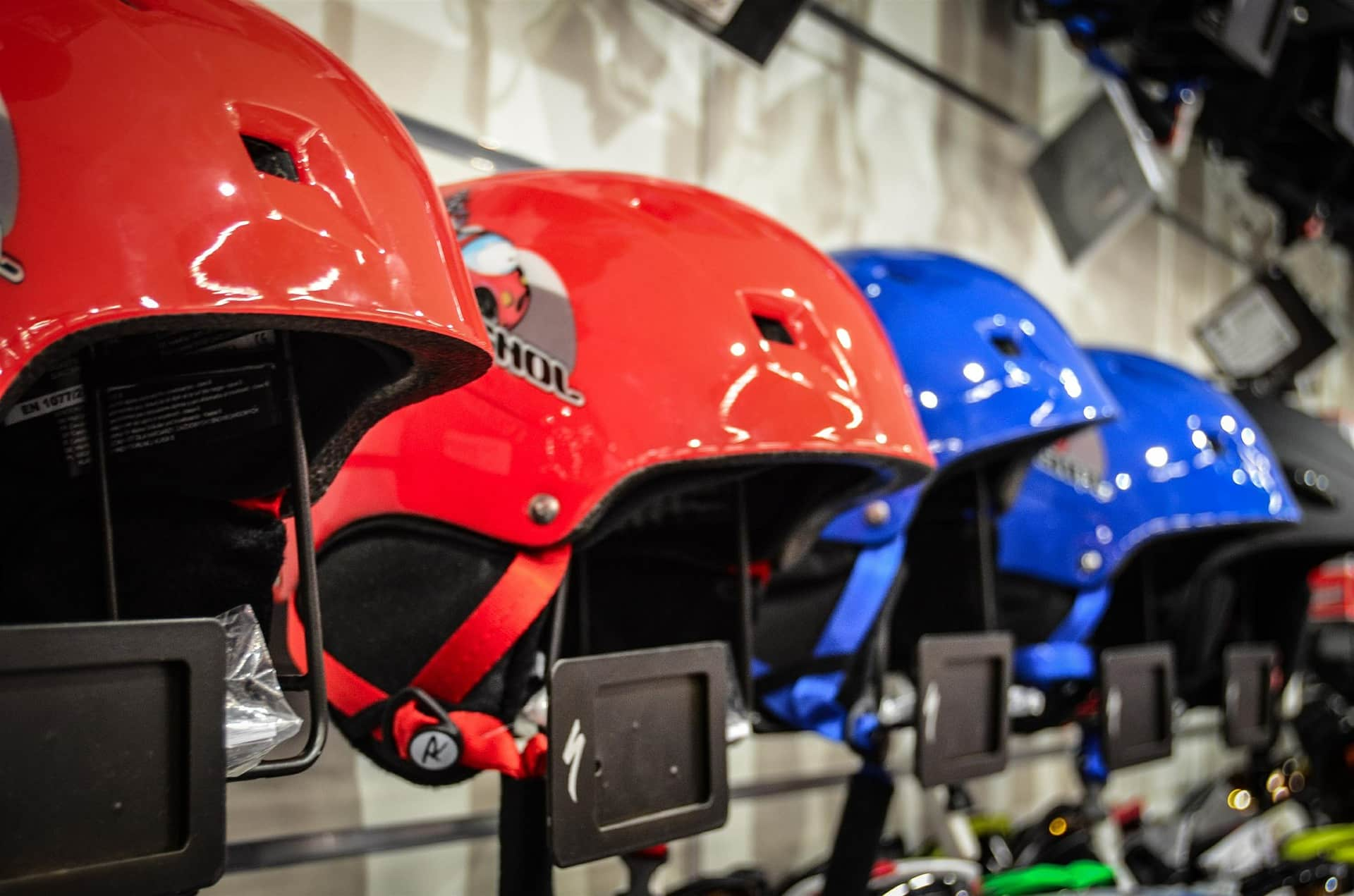 Row of red and blue ski helmets