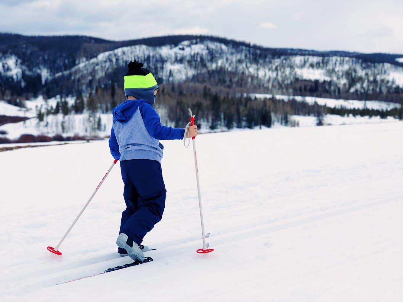 Young child using ski equipment