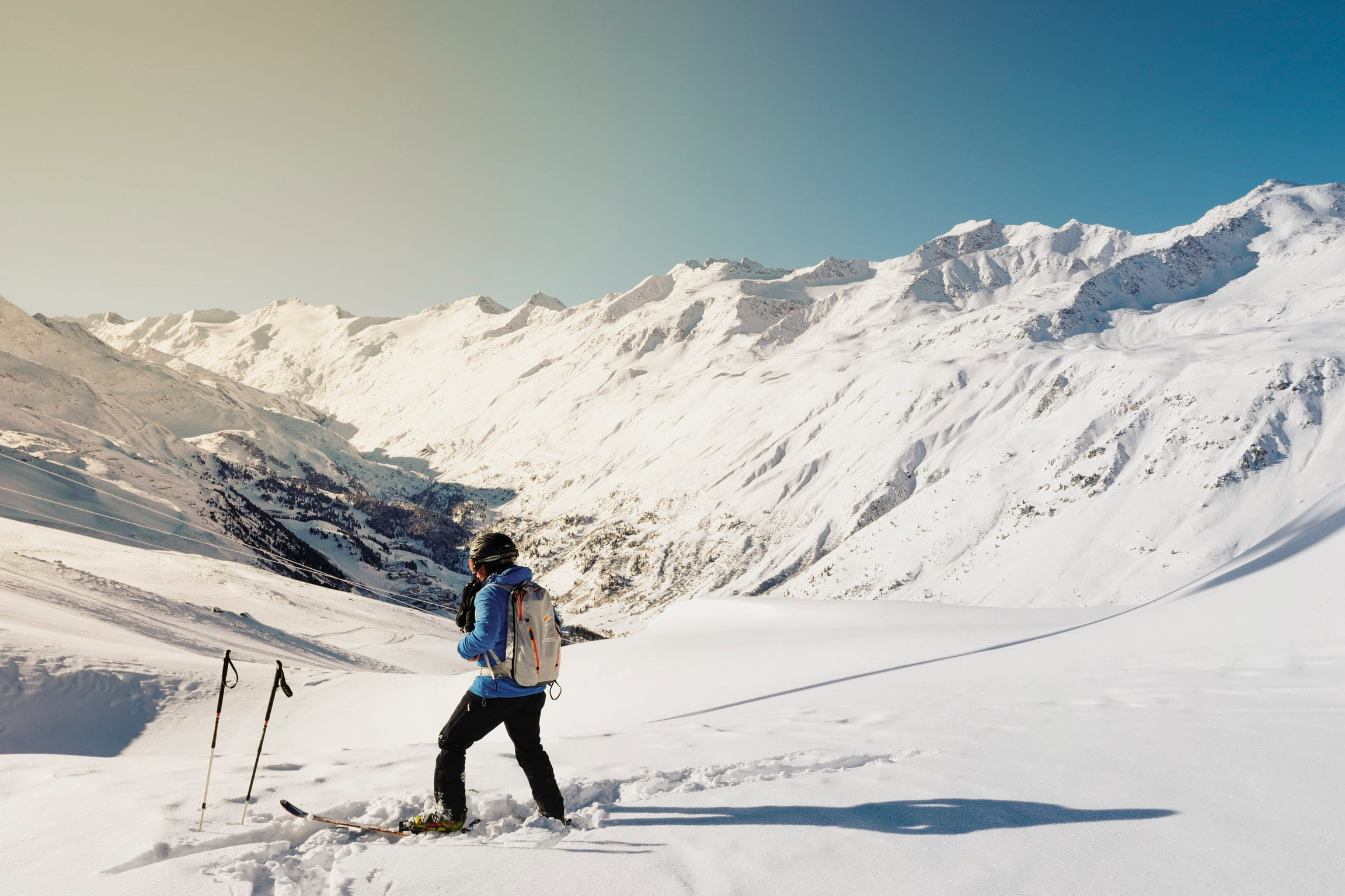 Skier surrounded by mountain slopes