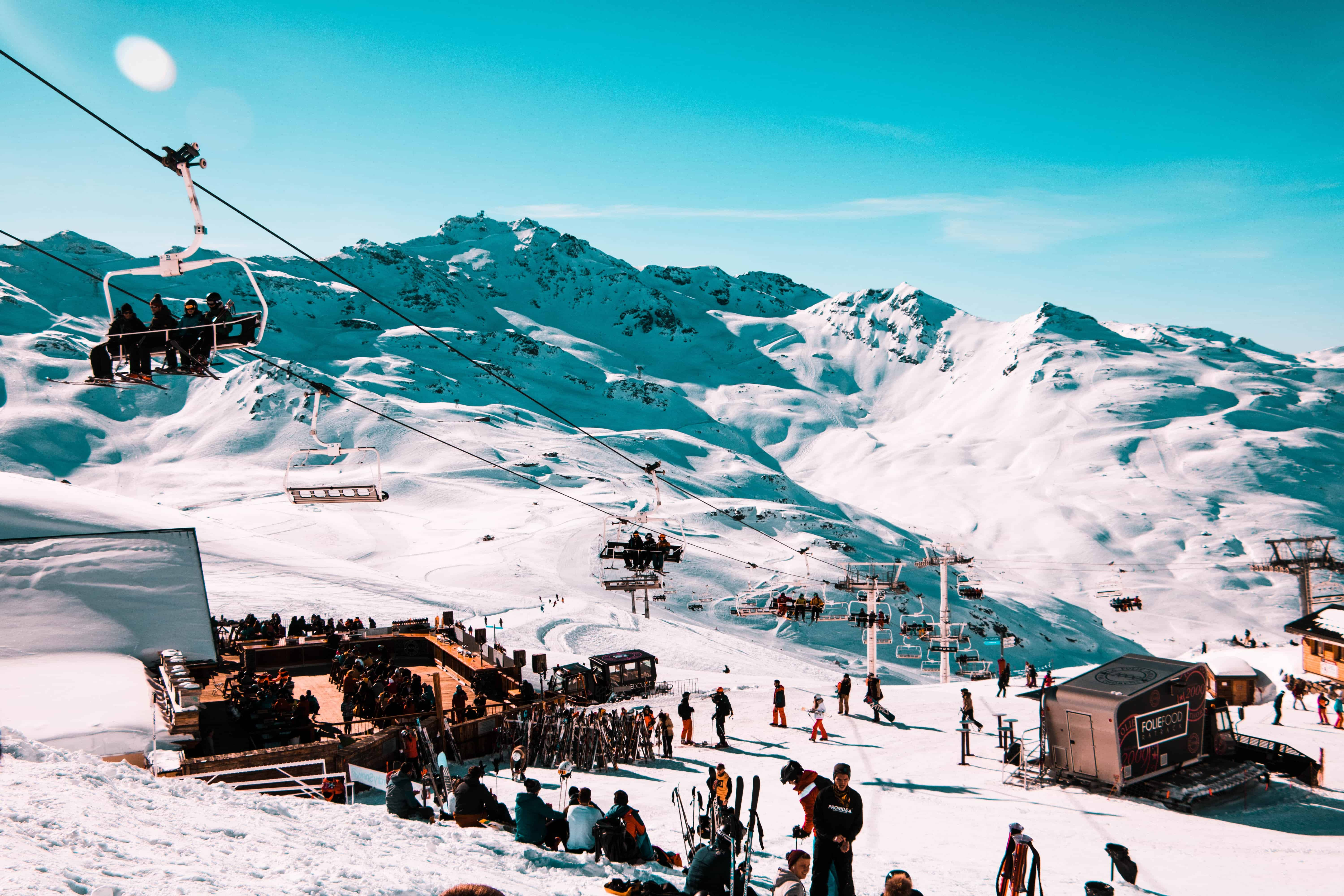 Ski resort with people, lifts and mountains