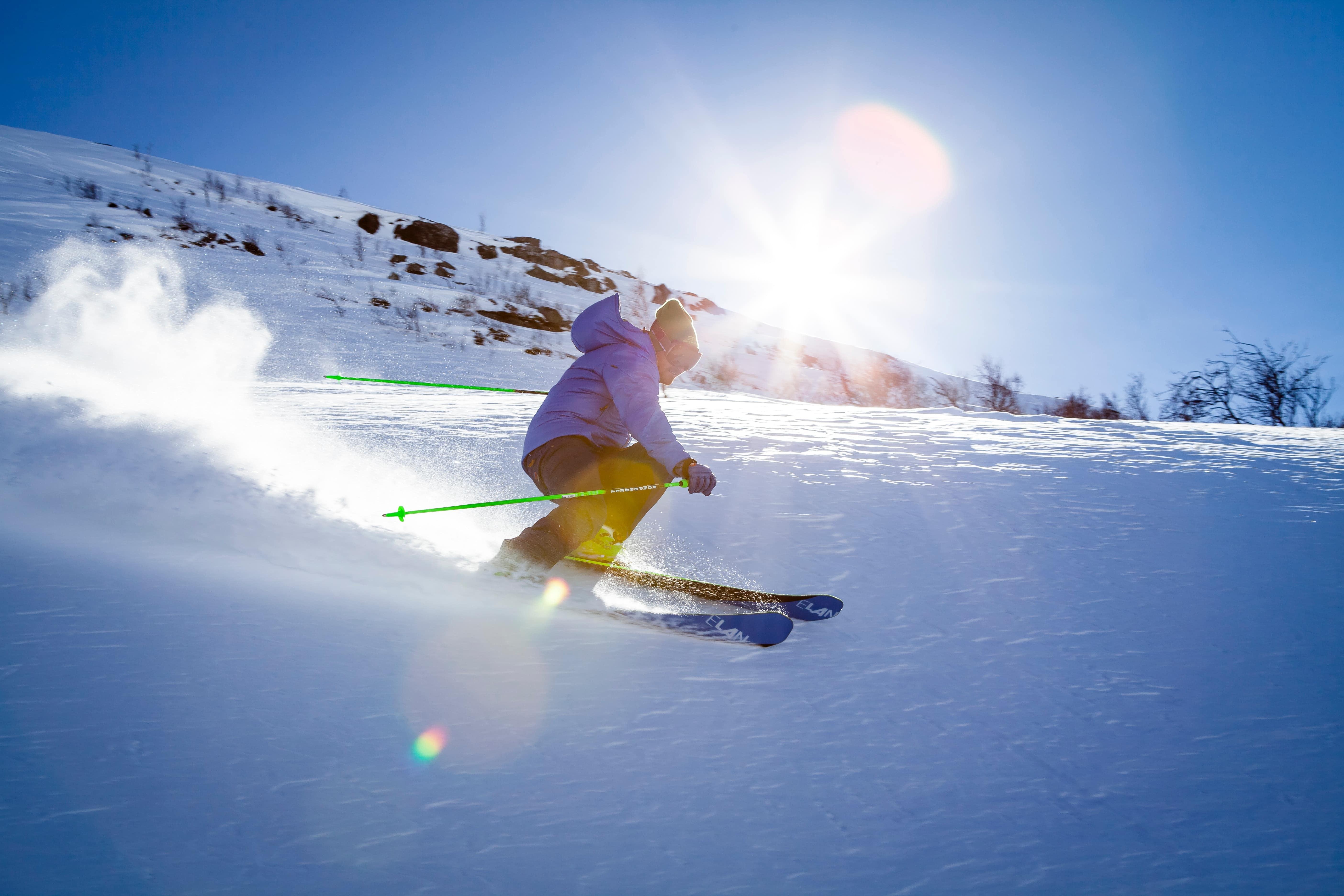 Skiing under blue skies