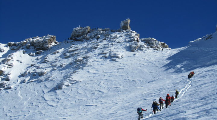 Hikers on a snowy mountain attempting the grand paradiso climb