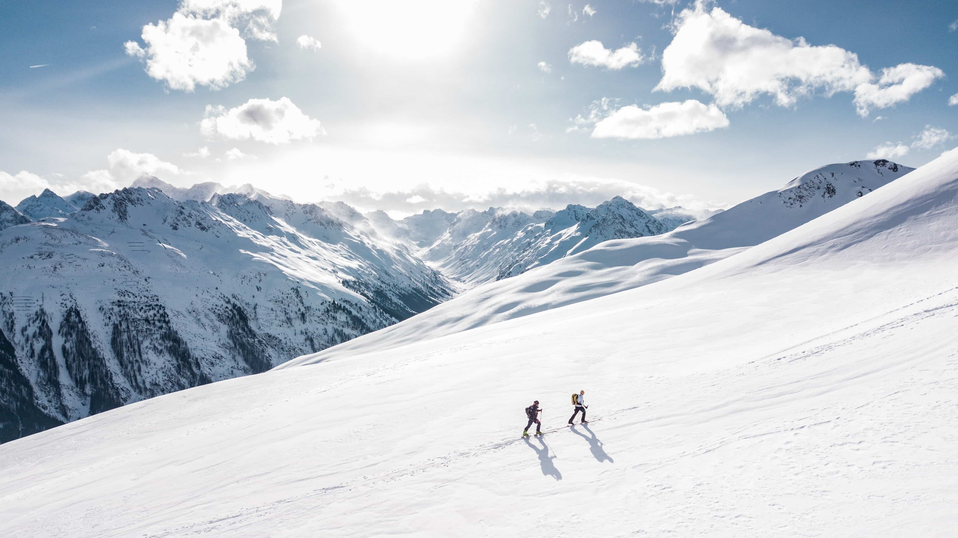 Two people ski mountaineering in the Alps