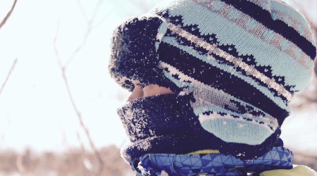 Child wearing hat in the snow