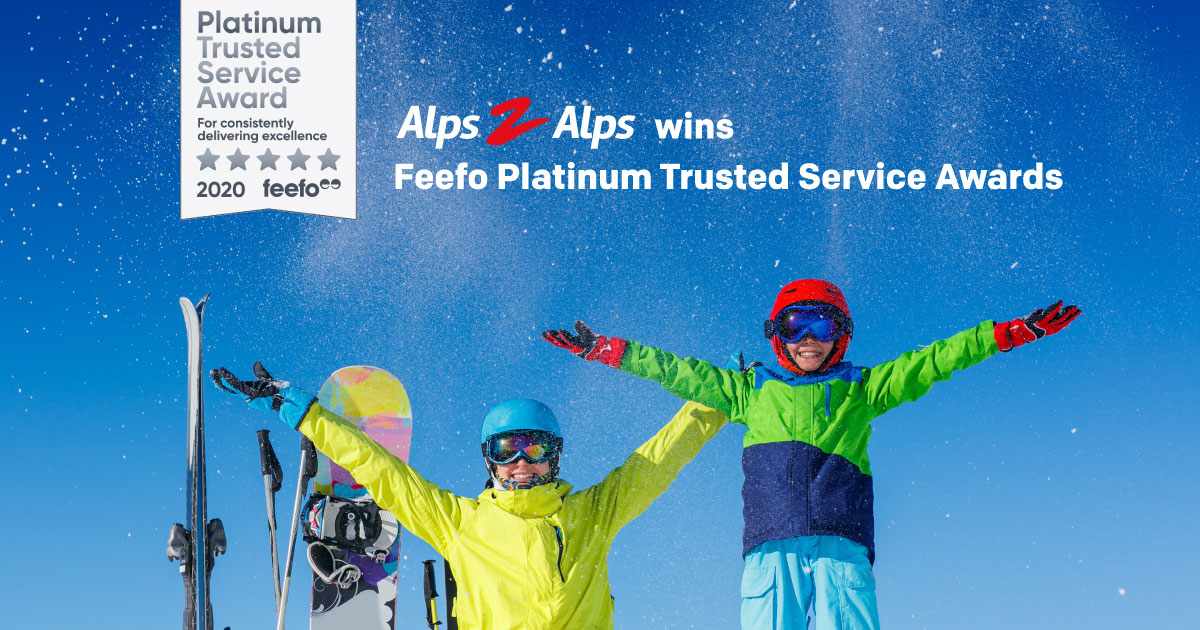 Happy skiers under a blue sky with text and Feefo award logo