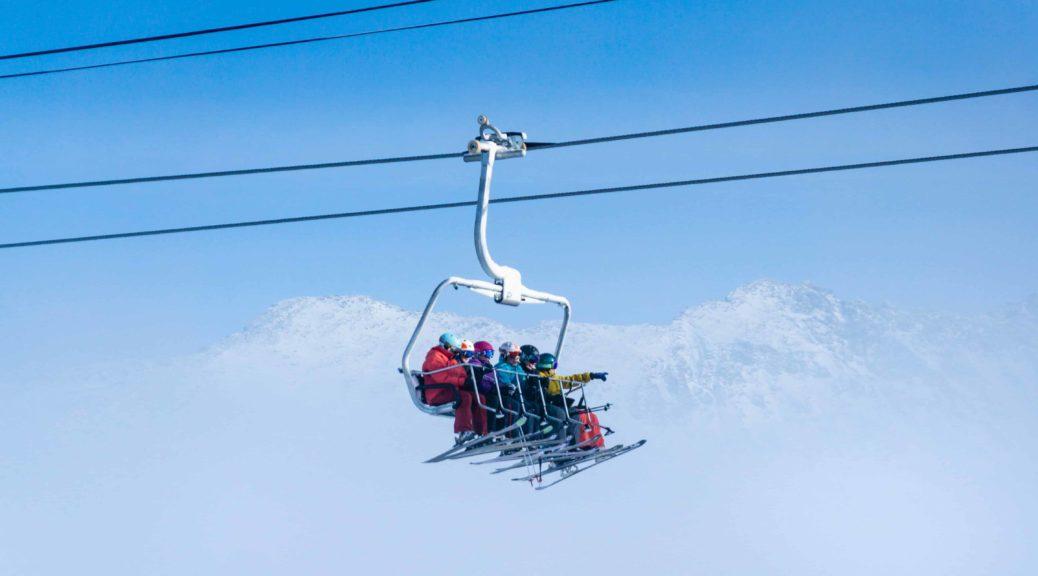 Skiers on ski lift